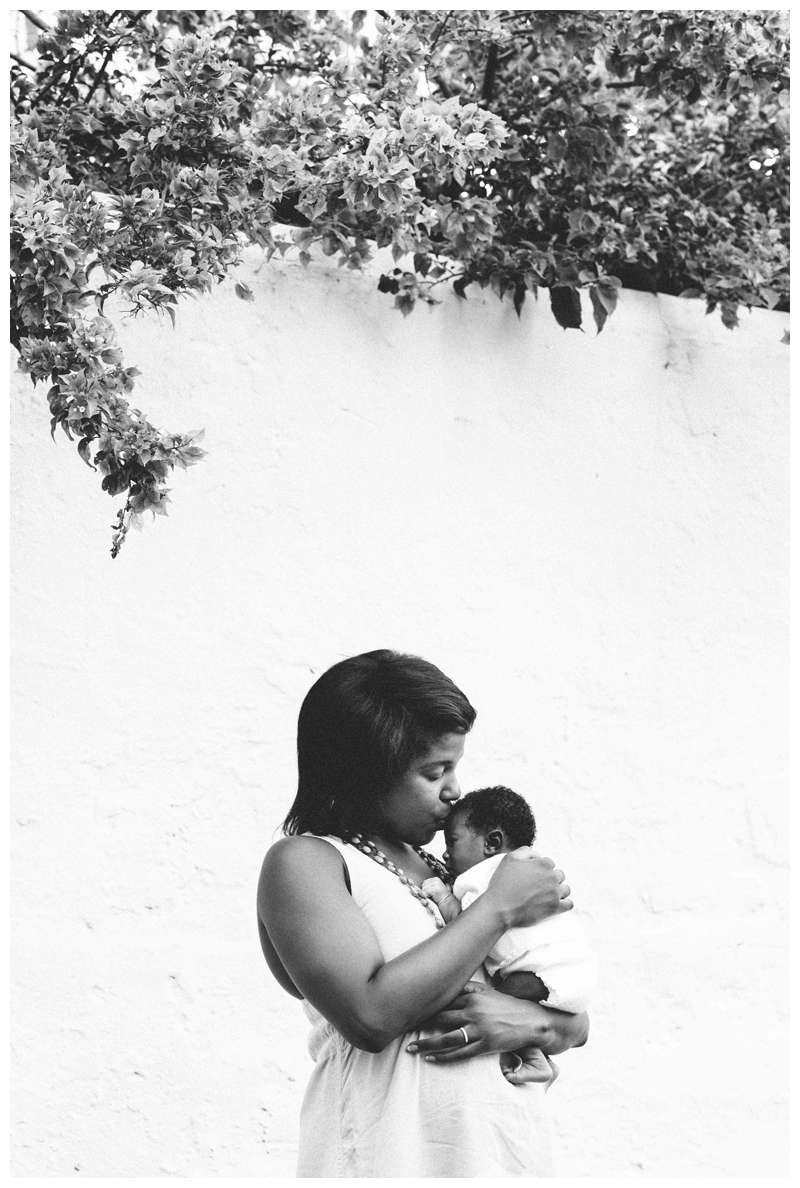 Mom kissing her baby girl. Baby's first photos in Coral Gables, FL. Photographed by Kristen M. Brown, Samba to the Sea Photography.