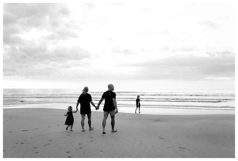 Family walking on the beach in Tamarindo. Family vacation beach photos in Costa Rica. Photographed by Kristen M. Brown of Samba to the Sea Photography.