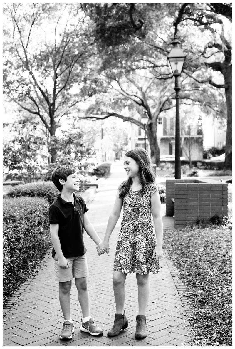 Brother and sister holding hands during historic Savannah Georgia family photos. Photographed by Kristen M. Brown of Samba to the Sea Photography.