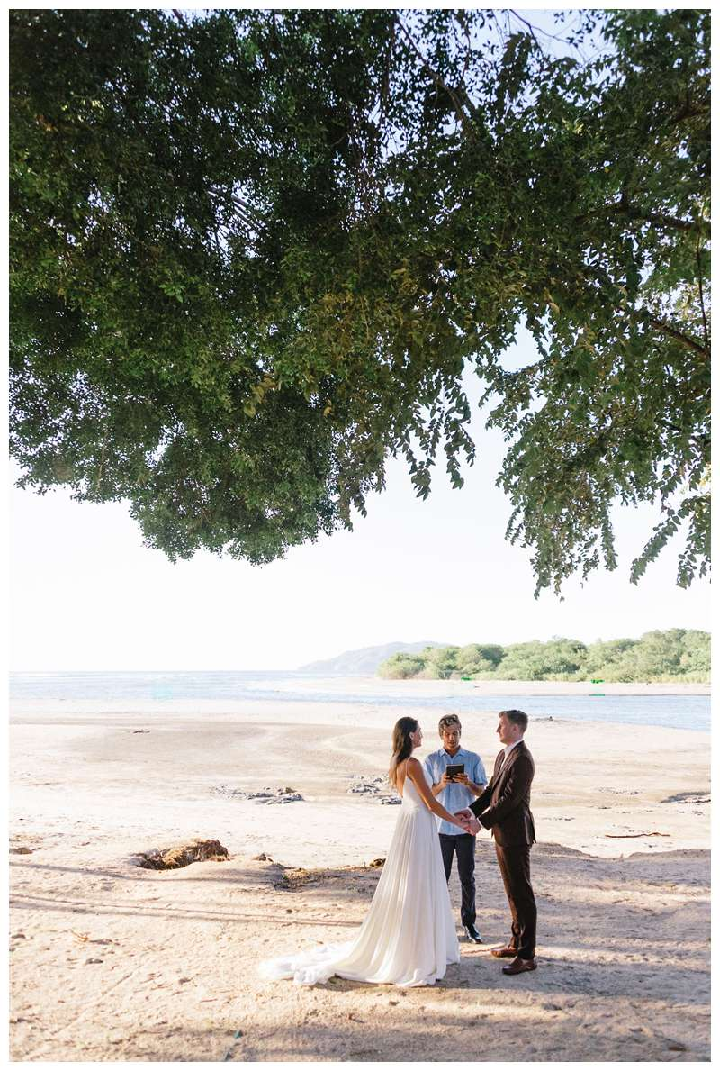 Honeymoon beach elopement in Costa Rica in Tamarindo. Photographed by Kristen M. Brown of Samba to the Sea Photography.