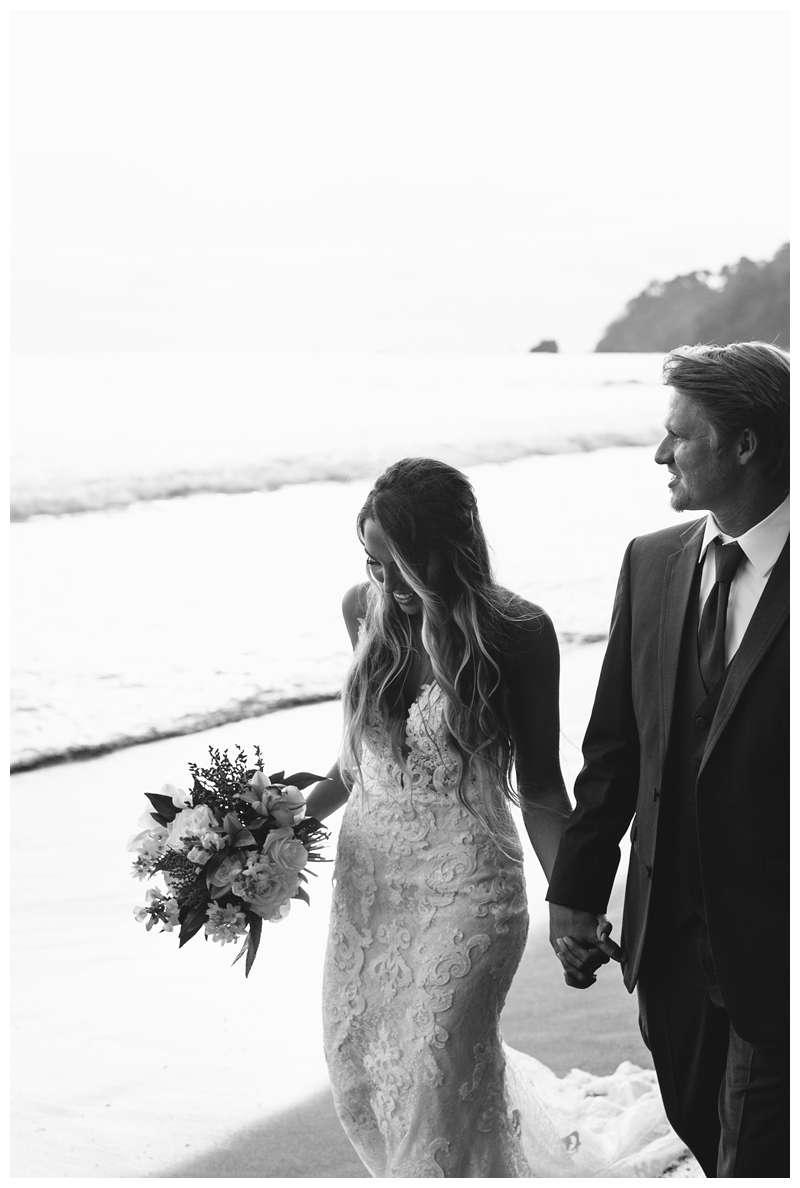 Bride and groom on the beach after their destination wedding in Manuel Antonio Costa Rica at Villa Punto de Vista.