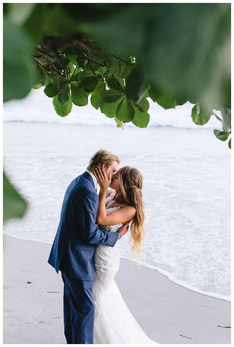 Bride and groom kissing on the beach after their destination wedding in Manuel Antonio Costa Rica at Villa Punto de Vista.