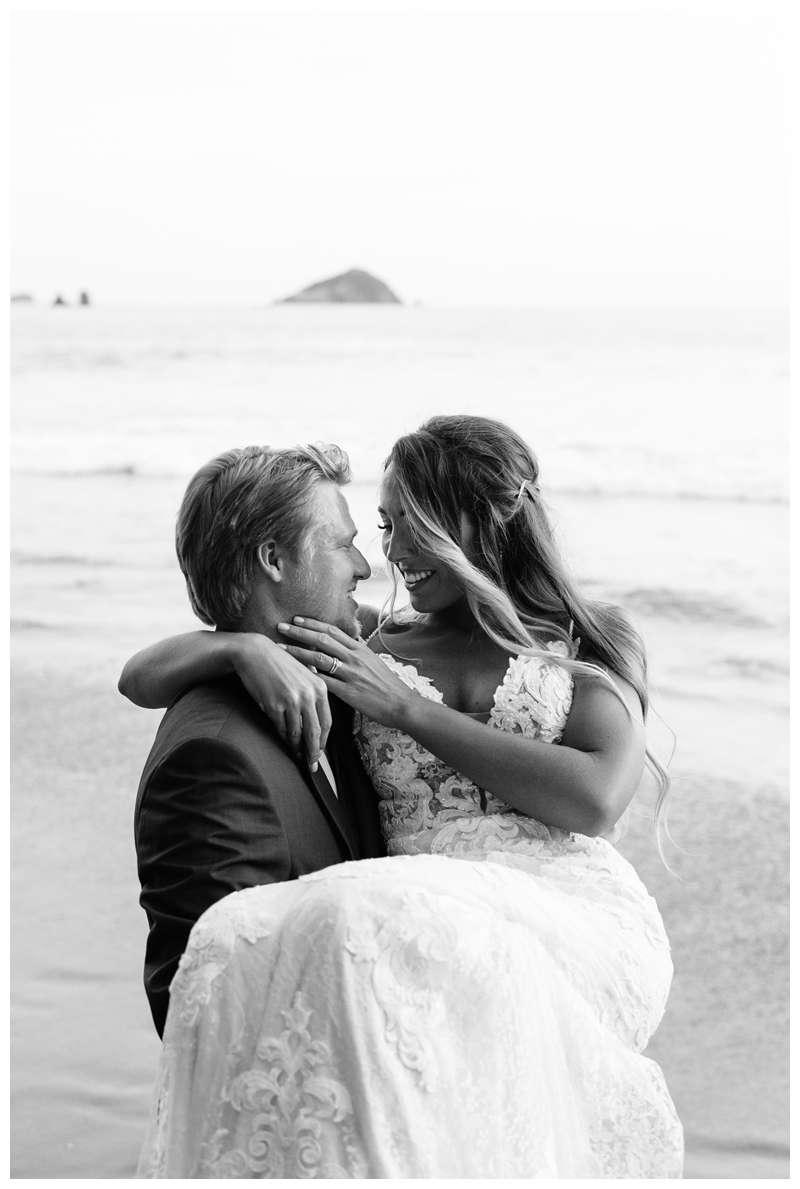Bride and groom dancing on the beach after their destination wedding in Manuel Antonio Costa Rica at Villa Punto de Vista.