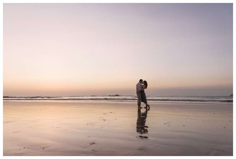 Couple kissing on the beach during sunset for their engagement photos in Tamarindo Beach Costa Rica. Photographed by Kristen M. Brown of Samba to the Sea.