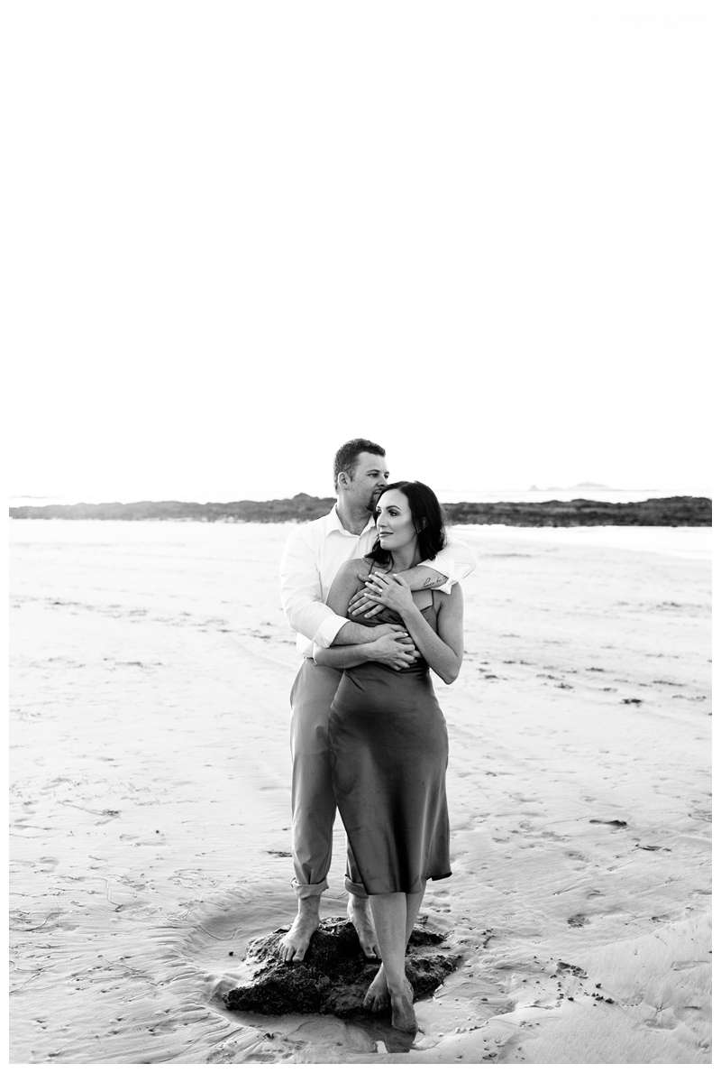 Black and white photo of couple on the beach for their engagement photos in Tamarindo Beach Costa Rica. Photographed by Kristen M. Brown of Samba to the Sea.