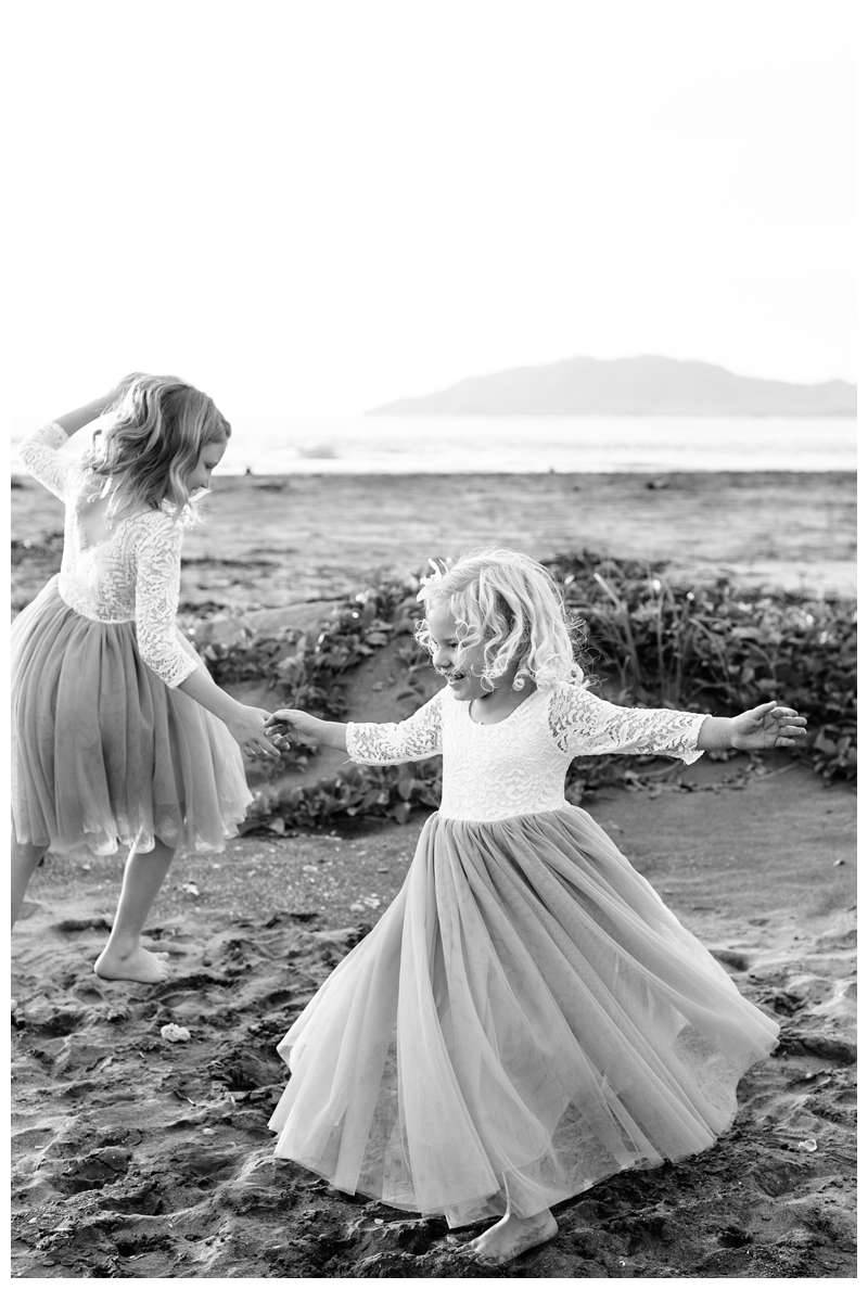 Bride and groom's children dancing on the beach after their family elopement in Tamarindo Costa Rica. Photographed by Kristen M. Brown of Samba to the Sea.