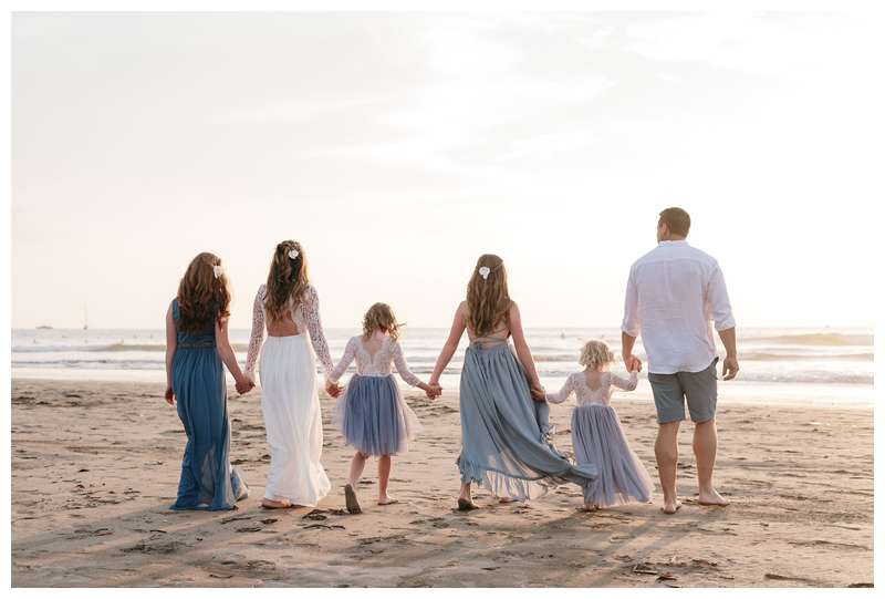 Family walking on the beach after their parrents' elopement in Tamarindo Costa Rica. Photographed by Kristen M. Brown of Samba to the Sea.