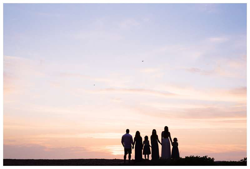 Family on the beach watching sunset after their parrents' elopement in Tamarindo Costa Rica. Photographed by Kristen M. Brown of Samba to the Sea.