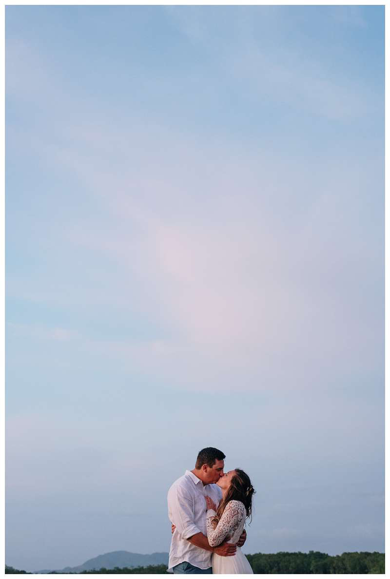 Bride and groom kissing during sunset on the beach after their family elopement in Tamarindo Costa Rica. Photographed by Kristen M. Brown of Samba to the Sea.
