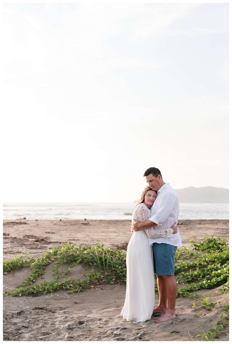 Bride and groom on the beach after their family elopement in Tamarindo Costa Rica. Photographed by Kristen M. Brown of Samba to the Sea.