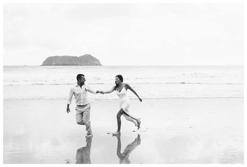 Bride and groom running on the beach after their intimate destination wedding in Manuel Antonio Costa Rica at Casa Diamante.