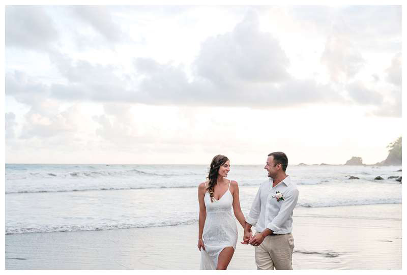 Bride and groom walking on the beach after their intimate destination wedding in Manuel Antonio Costa Rica at Casa Diamante.