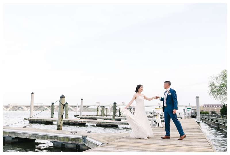 Bride and groom dancing on the Potomac River after their intimate historic Alexandria Virgina spring wedding. Photographed by Kristen M. Brown of Samba to the Sea.