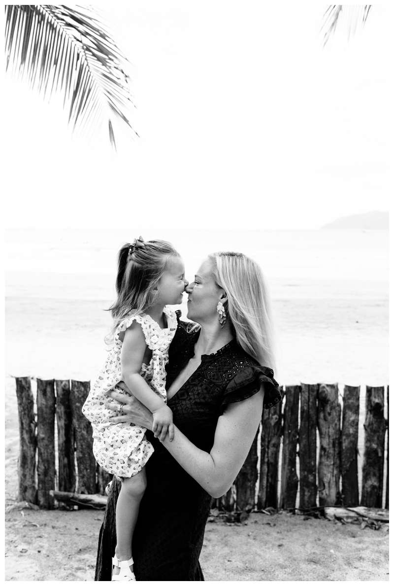 Little girl kissing her mom on the nose. Tamarindo Beach family photos in Costa Rica. Photographed by Kristen M. Brown of Samba to the Sea.