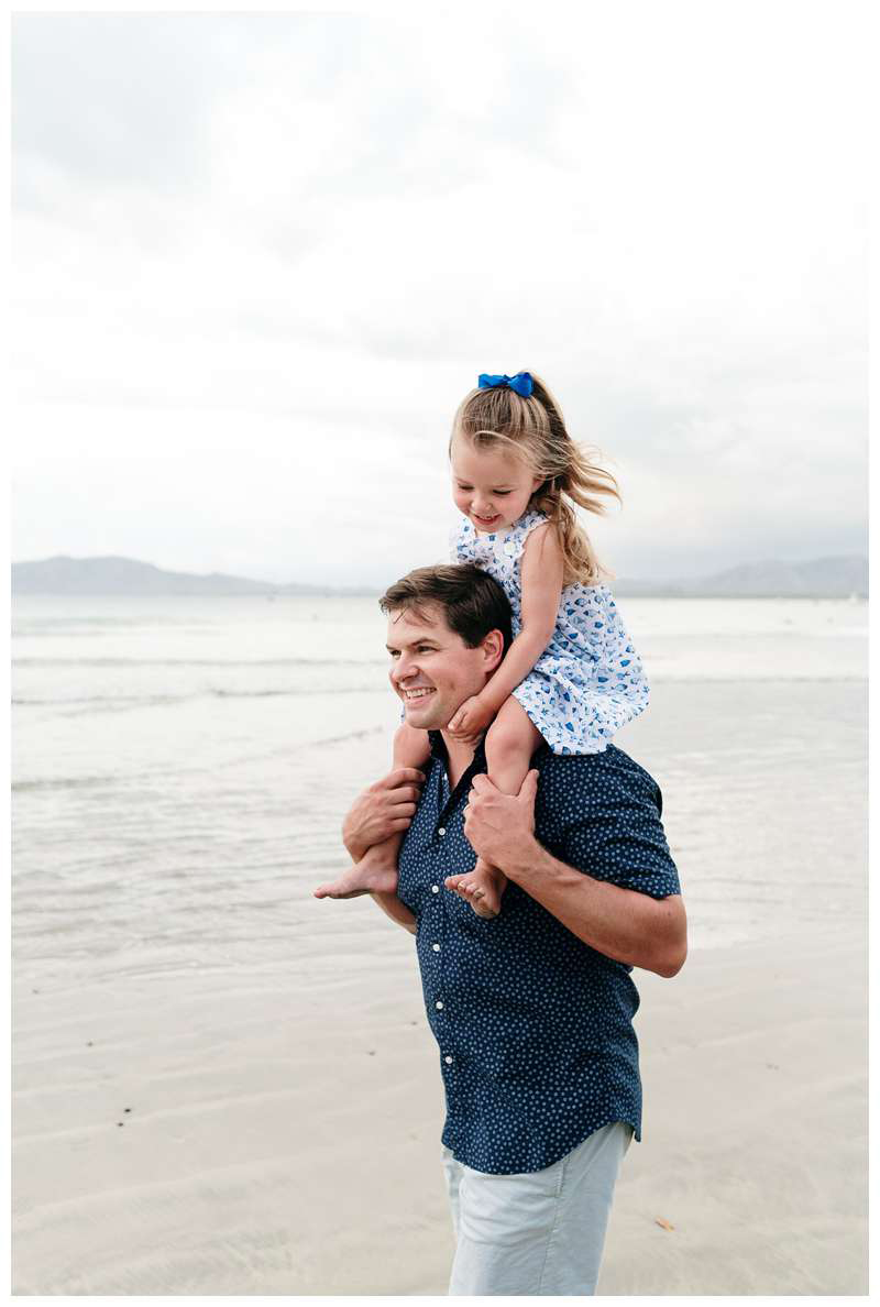 Dad giving his little girl a piggy back ride. Tamarindo Beach family photos in Costa Rica. Photographed by Kristen M. Brown of Samba to the Sea.