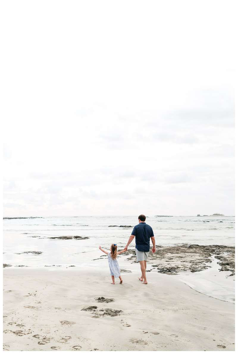 Dad walking with his little girl on the beach. Tamarindo Beach family photos in Costa Rica. Photographed by Kristen M. Brown of Samba to the Sea.