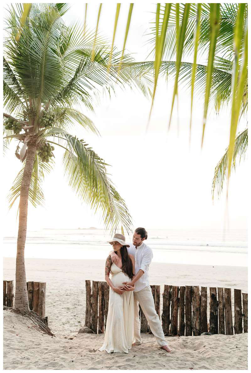 Pregnant woman and her husband on the beach in Tamarindo Costa Rica. Babymoon in Costa Rica maternity photos. Photographed by Kristen M. Brown of Samba to the Sea.