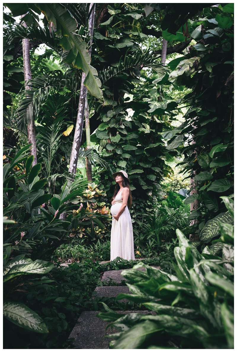 Photo of beautiful pregnant woman in a jungle garden in Costa Rica. Babymoon in Costa Rica maternity photos. Photographed by Kristen M. Brown of Samba to the Sea.