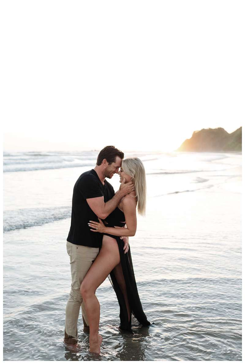 Couple kissing on the beach in Nosara. Engagement photos on the beach in Playa Guiones Nosara Costa Rica. Photographed by Kristen M. Brown of Samba to the Sea.
