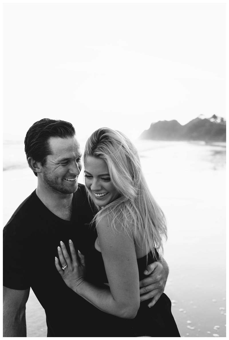 Couple laughing on the beach in Nosara. Engagement photos on the beach in Playa Guiones Nosara Costa Rica. Photographed by Kristen M. Brown of Samba to the Sea.