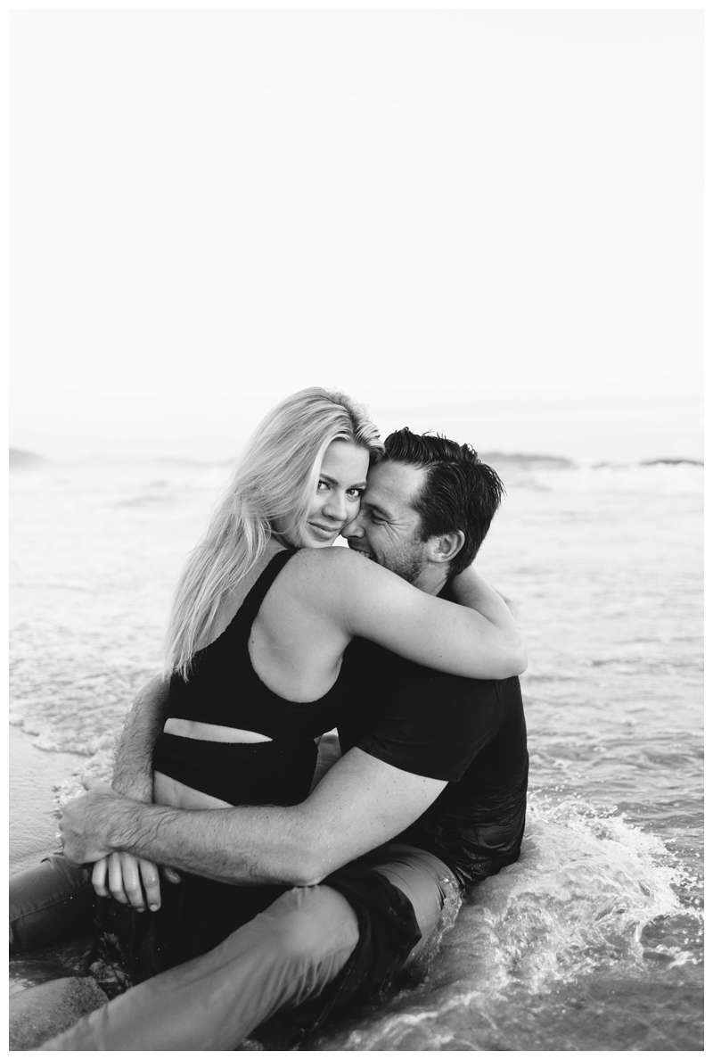 Couple playing in the waves on the beach in Nosara. Engagement photos on the beach in Playa Guiones Nosara Costa Rica. Photographed by Kristen M. Brown of Samba to the Sea.