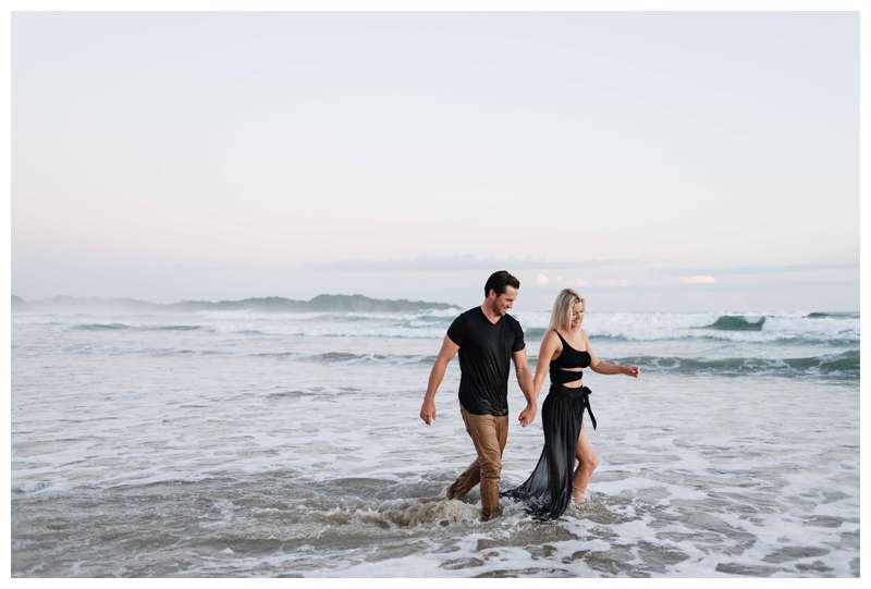 Couple walking on the beach in Nosara. Engagement photos on the beach in Playa Guiones Nosara Costa Rica. Photographed by Kristen M. Brown of Samba to the Sea.