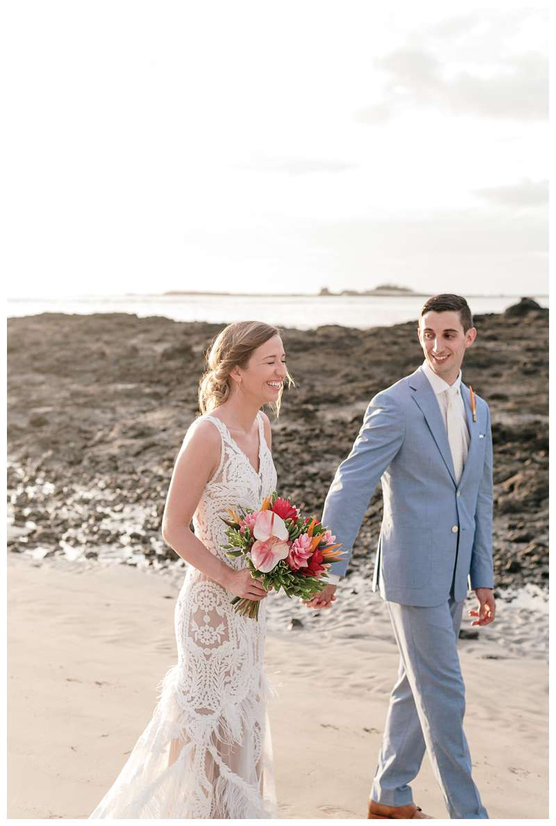Bride and groom walking on the beach during their minimony in Costa Rica.  Photographed by Kristen M. Brown of Samba to the Sea.