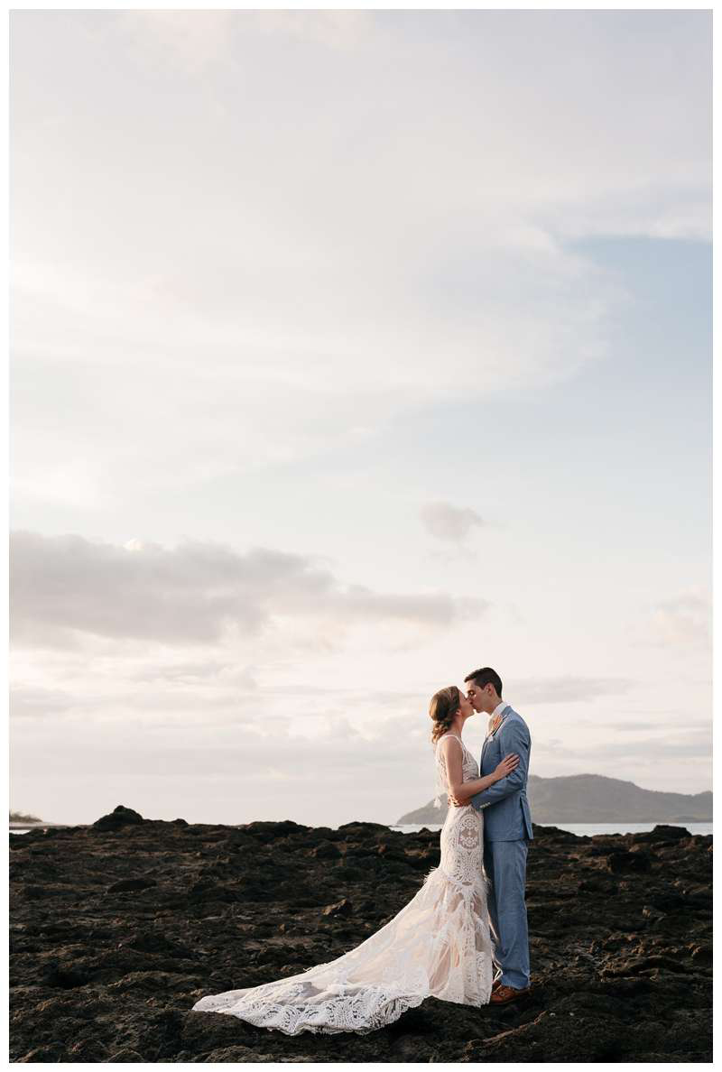 Bride and groom kissing on the beach during their minimony in Costa Rica.  Photographed by Kristen M. Brown of Samba to the Sea.