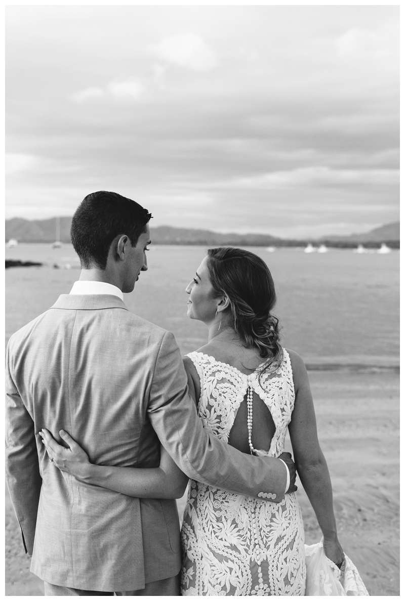 Bride and groom laughing on the beach during their minimony in Costa Rica.  Photographed by Kristen M. Brown of Samba to the Sea.