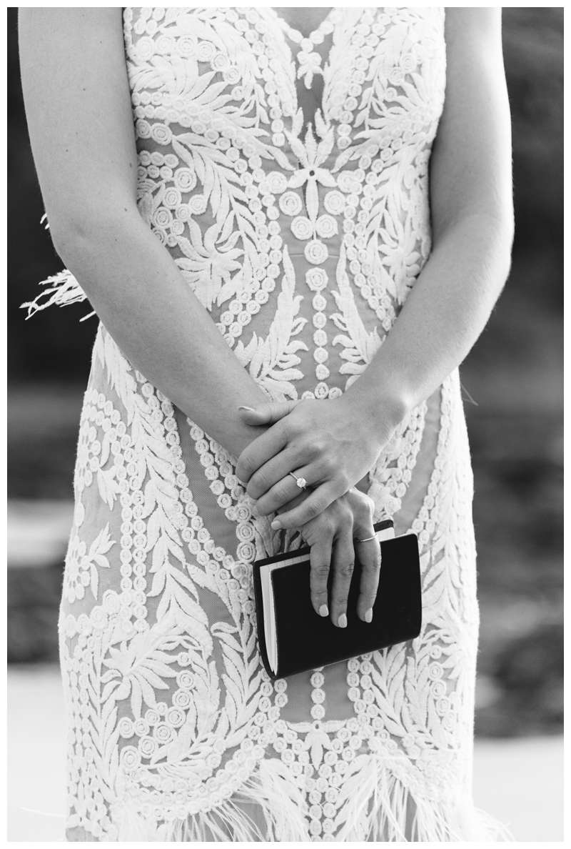 Bride holding her vows during her minimony in Costa Rica on the beach in Tamarindo.  Photographed by Kristen M. Brown of Samba to the Sea.