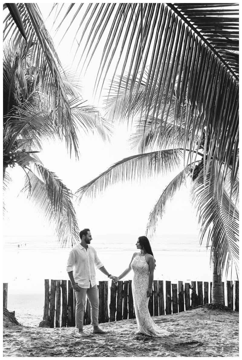 Black and white photo of husband and wife during their anniversary photos in Costa Rica. Photographed by Kristen M. Brown of Samba to the Sea Photography.