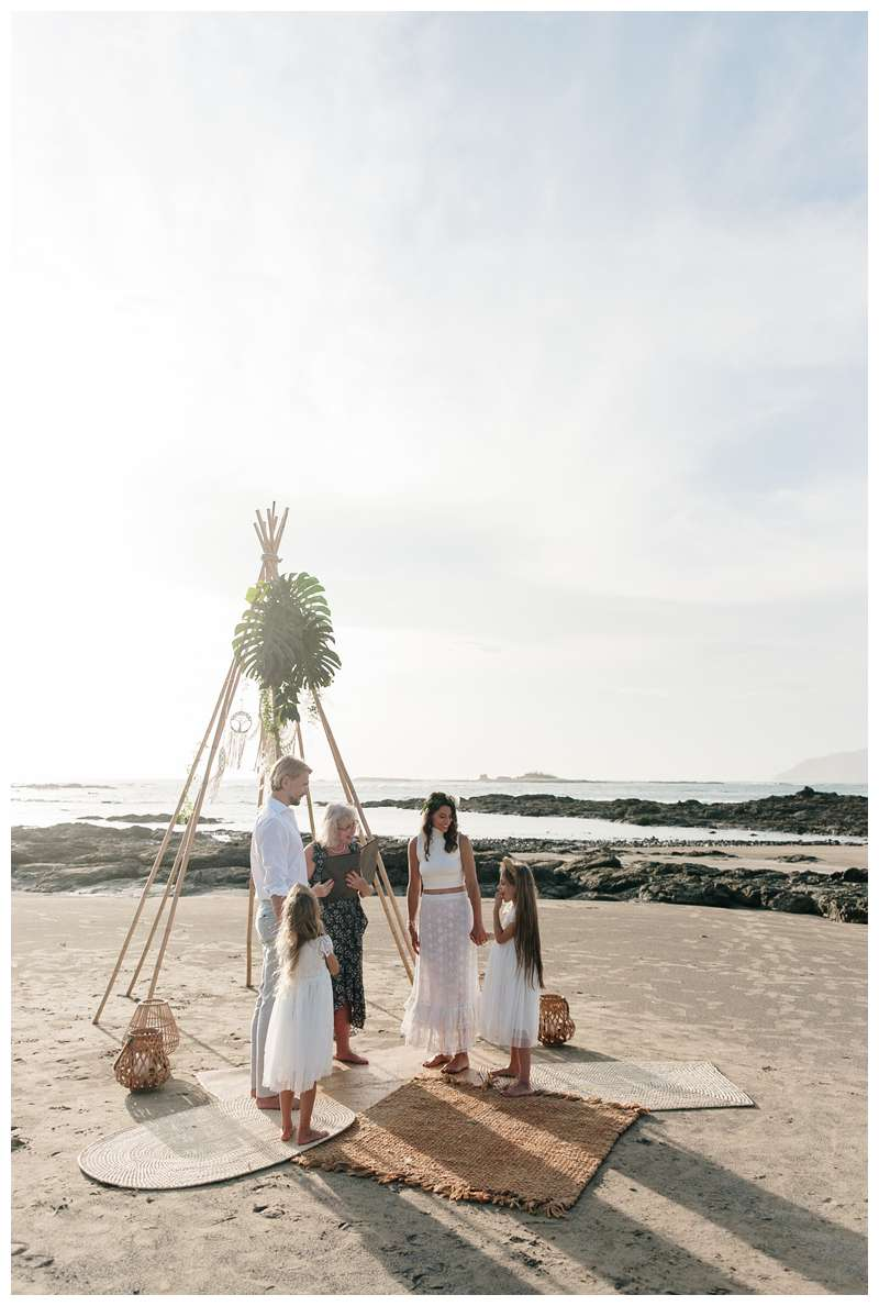 Boho wood teepee vow renewal beach ceremony. Beach vow renewal in Tamarindo Costa Rica. Photographed by Kristen M. Brown of Samba to the Sea.