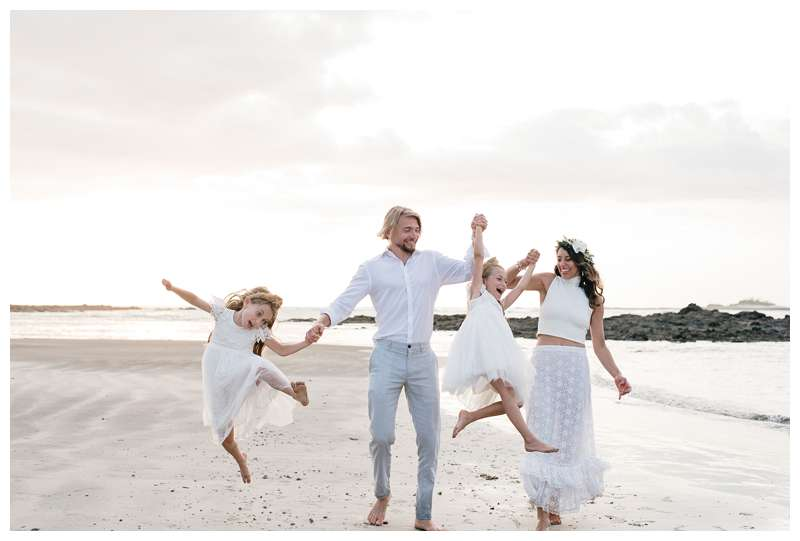 Family walking on the beach after their beach vow renewal in Tamarindo Costa Rica. Photographed by Kristen M. Brown of Samba to the Sea.