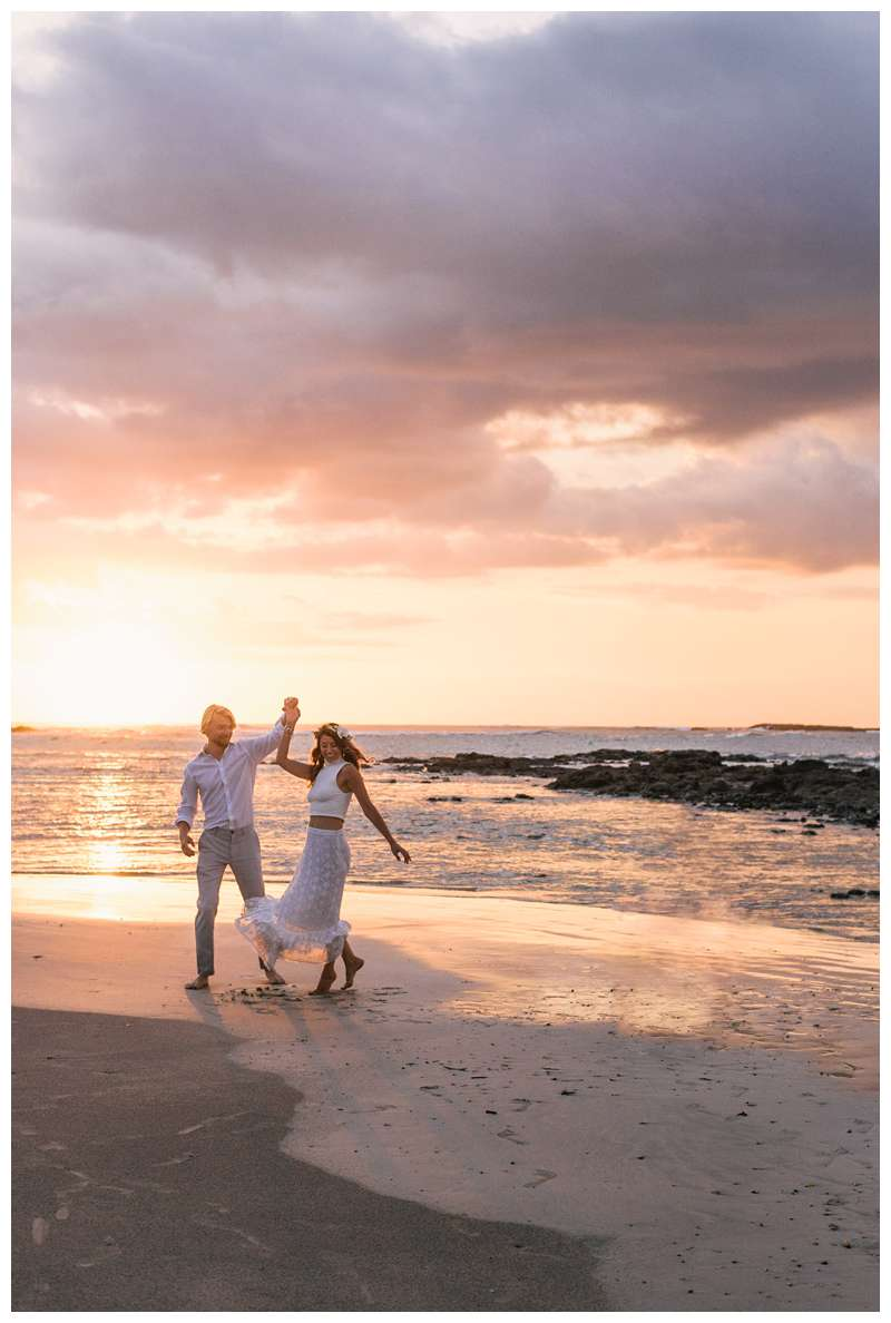 Husband and wife dancing on the beach at sunset after their beach vow renewal in Tamarindo Costa Rica. Photographed by Kristen M. Brown of Samba to the Sea.