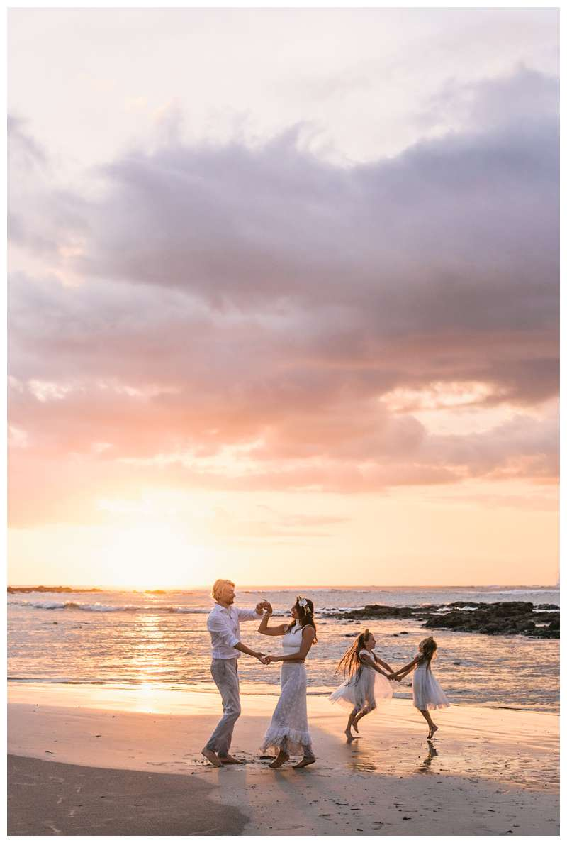 Family dancing on the beach at sunset after their beach vow renewal in Tamarindo Costa Rica. Photographed by Kristen M. Brown of Samba to the Sea.