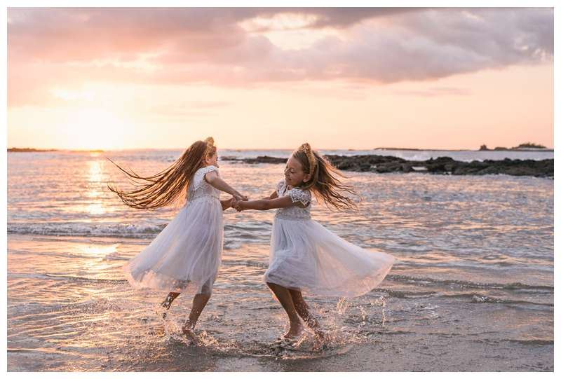 Sisters dancing on the beach at sunset after their family beach vow renewal in Tamarindo Costa Rica. Photographed by Kristen M. Brown of Samba to the Sea.